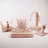 #11-3-S50 Champagne Pink Leatherette Pillow Bracelet & Bangle Display. | Nile Corp