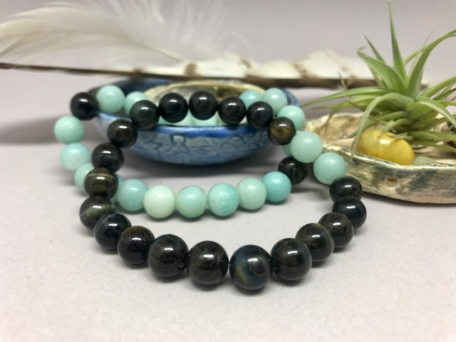 Handcrafted mala prayer natural gemstone bracelets, made in NJ by Weber's Art Studio.  Find a calmer mind, body & soul with 8mm gemstone bracelets on Earth Wood & Bone.