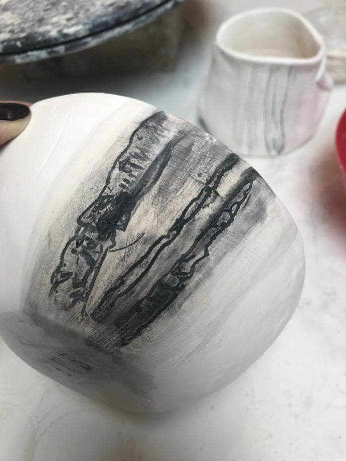 Working in the studio, underglazing porcelain bowls.