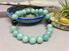Handcrafted mala prayer natural gemstone bracelets, made in NJ by Weber's Art Studio.  Find a calmer mind, body & soul with 8mm gemstone bracelets in Earth Wood & Bone.