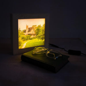 A light box switched on and gently glowing in the dark