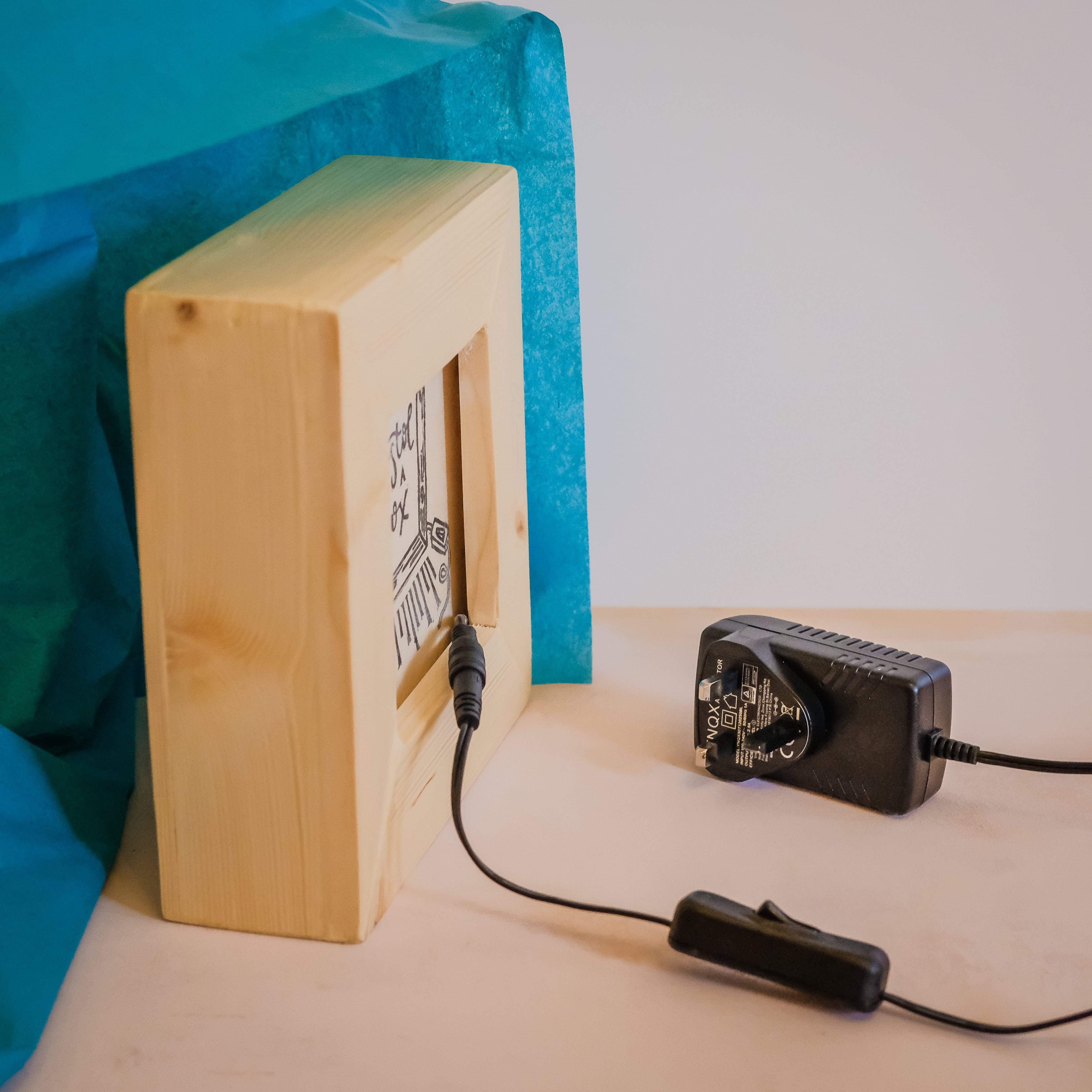 LED powered light box with a power adapter