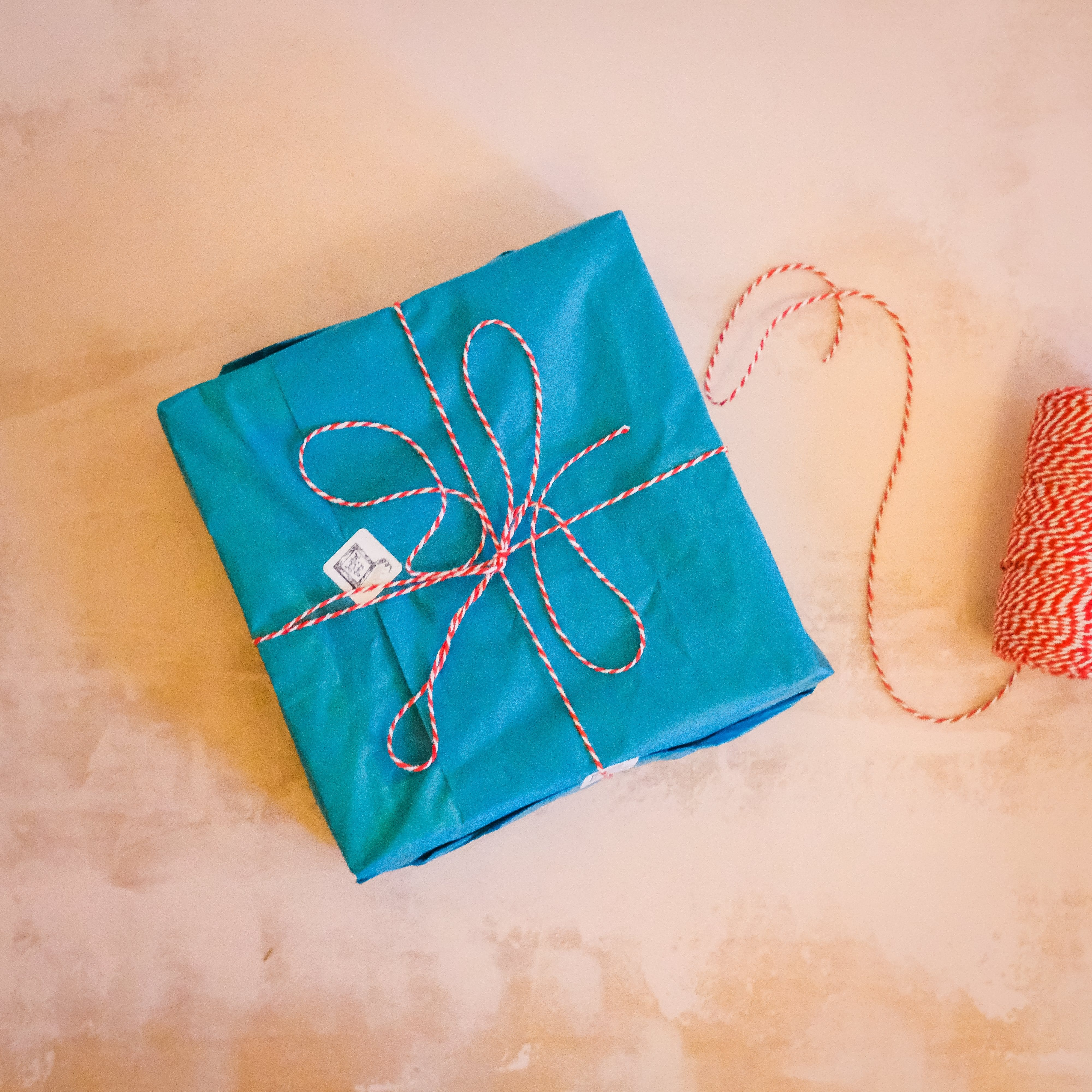 Wooden light box wrapped in blue tissue paper