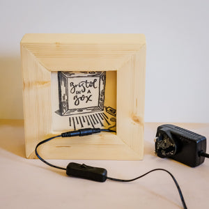 A handmade light box with on/off switch