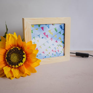 A wooden light up frame showing an image of bunting