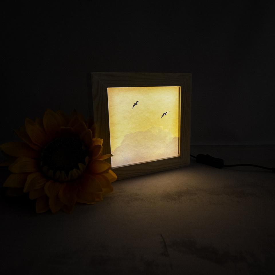 Wooden light box turned on and glowing softly
