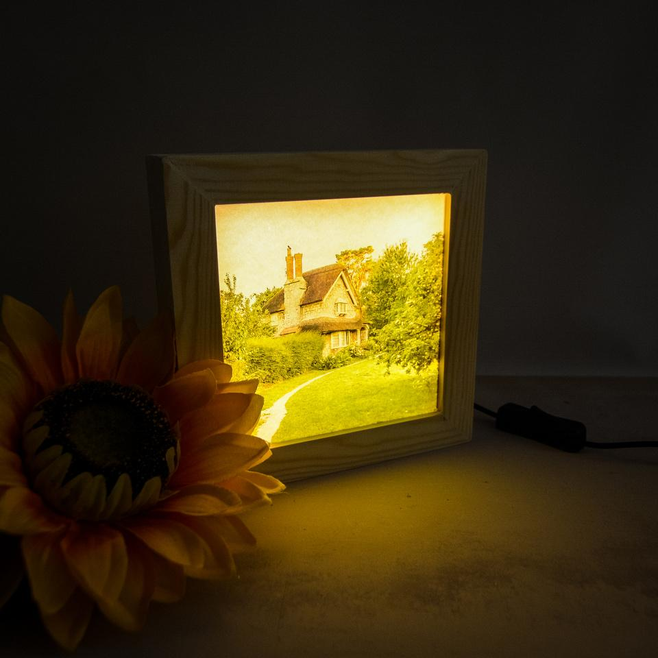 Picture of Blaise Hamlet placed in a backlit frame