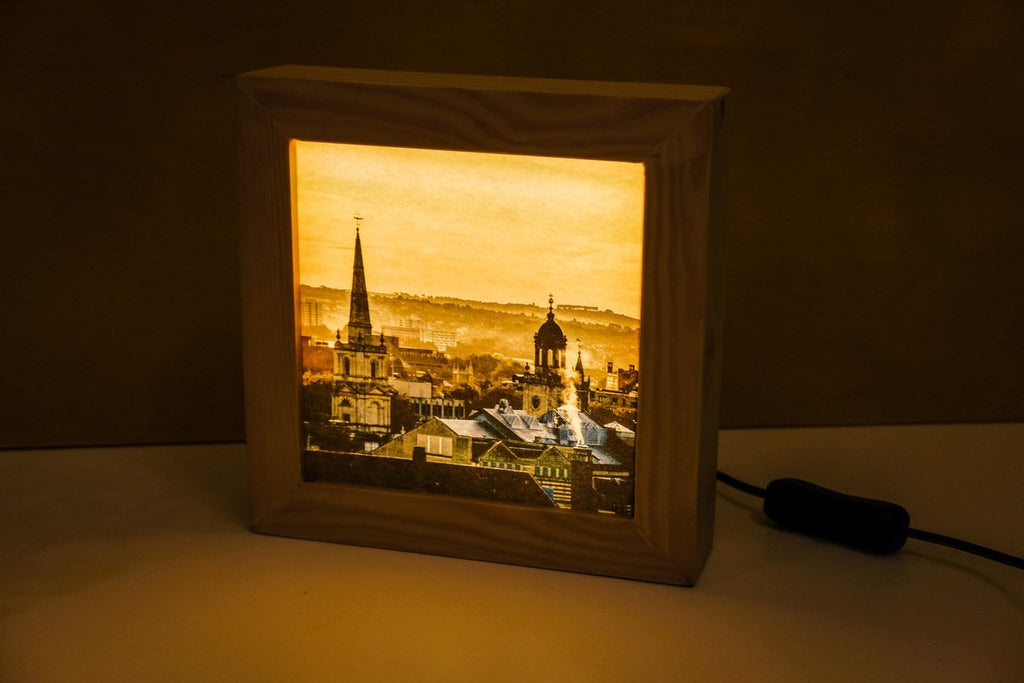 Handmade light box showing a picture of Bristol in the fog