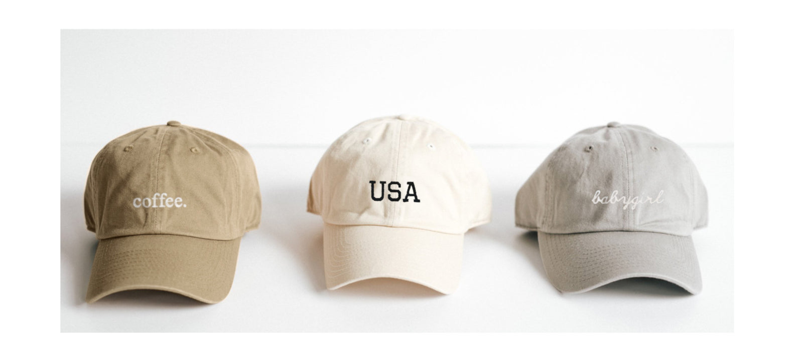 three baseball hats with embroidery