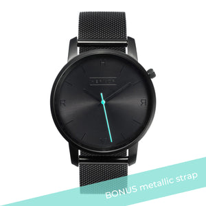 All black Hervor watch with black metallic mesh strap and a turquoise accent second hand