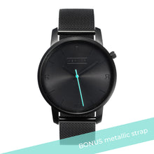 Load image into Gallery viewer, All black Hervor watch with black metallic mesh strap and a turquoise accent second hand