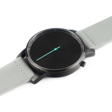 Load image into Gallery viewer, All black Hervor watch with dove grey leather strap and a turquoise accent second hand
