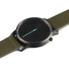 Load image into Gallery viewer, All black Hervor watch with olive khaki green leather strap and a turquoise accent second hand