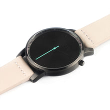 Load image into Gallery viewer, All black Hervor watch with light pink skin tone leather strap and a turquoise accent second hand