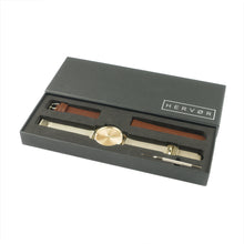 Load image into Gallery viewer, Gold Hervor watch in black packaging includes strap adjustment tool