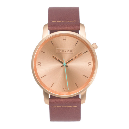 All rose gold Hervor watch with dusty rose dark pink leather strap and a turquoise accent second hand