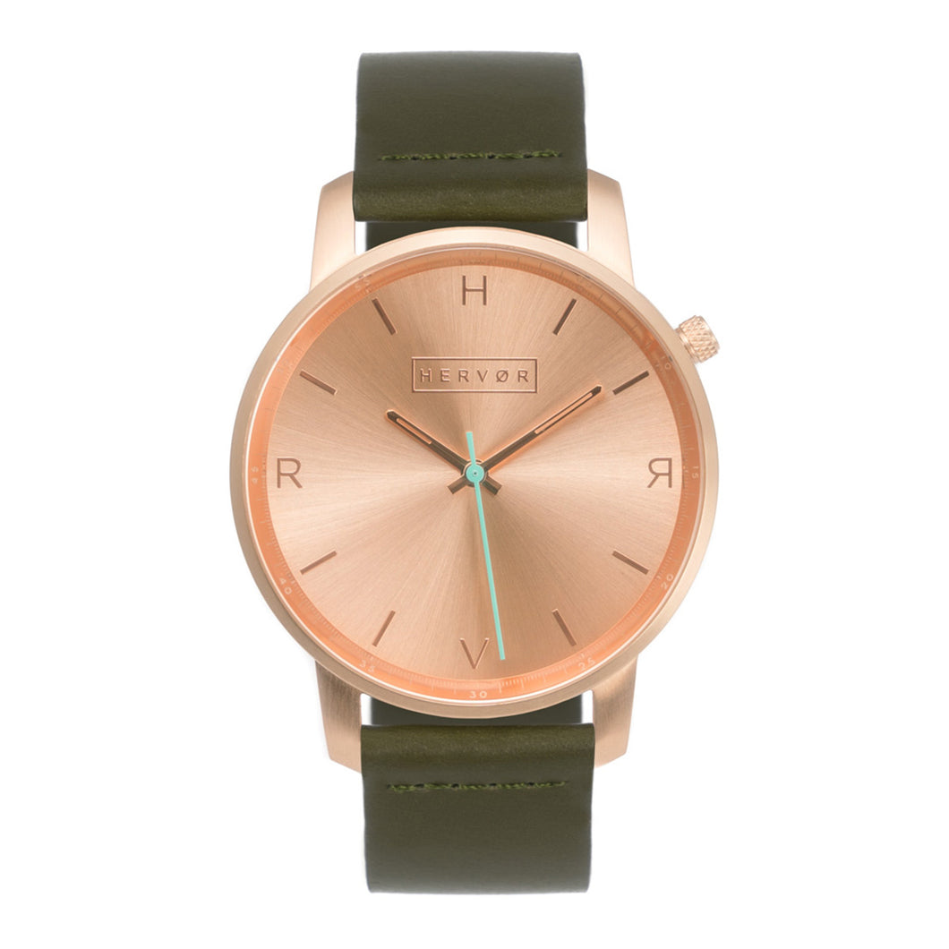All rose gold Hervor watch with olive khaki green leather strap and a turquoise accent second hand