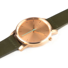 Load image into Gallery viewer, All rose gold Hervor watch with olive khaki green leather strap and a turquoise accent second hand