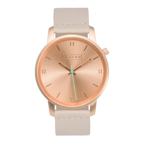 All rose gold Hervor watch with light pink skin tone leather strap and a turquoise accent second hand