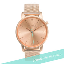 Load image into Gallery viewer, All rose gold Hervor watch with rose gold metallic mesh strap and a turquoise accent second hand