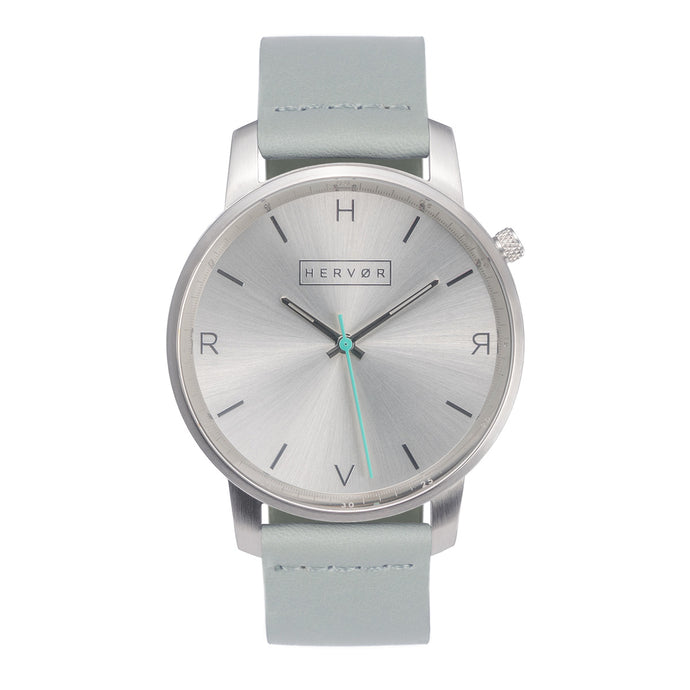 All silver Hervor watch with dove grey leather strap and a turquoise accent second hand