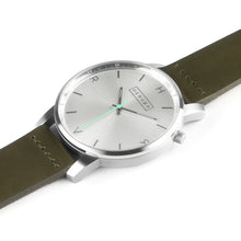 Load image into Gallery viewer, All silver Hervor watch with olive khaki green leather strap and a turquoise accent second hand