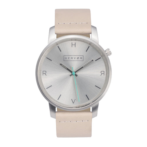 All silver Hervor watch with light pink skin tone leather strap and a turquoise accent second hand