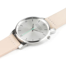 Load image into Gallery viewer, All silver Hervor watch with light pink skin tone leather strap and a turquoise accent second hand