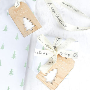 Christmas Wrapping Paper With Ribbon and Wooden Tag