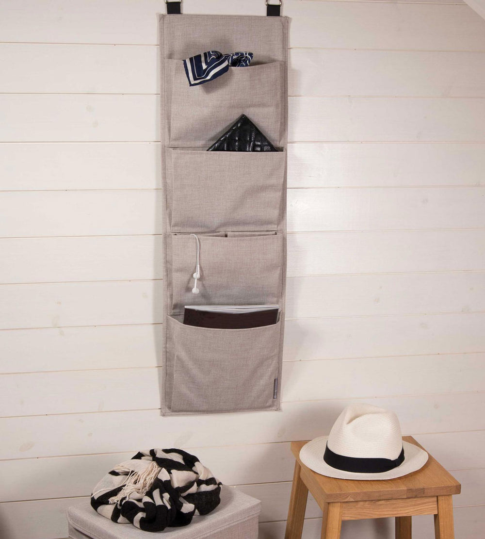 beige hanging fabric wall storage