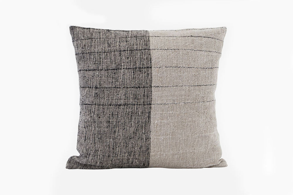 black and neutral cushion
