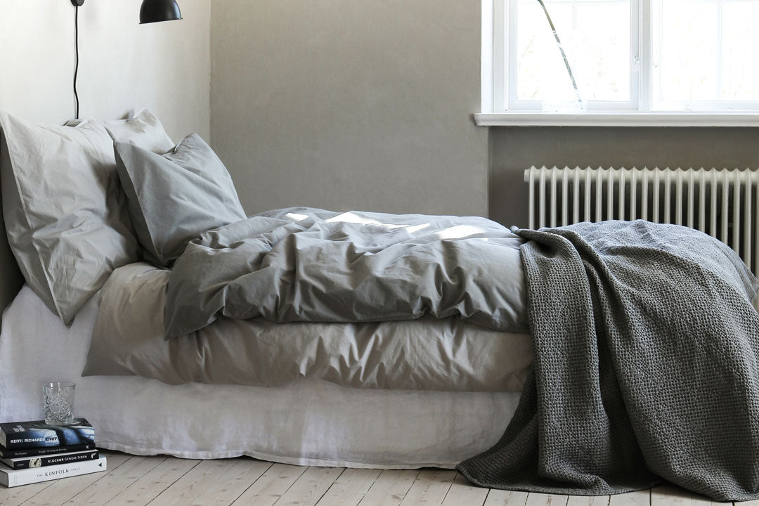 dove grey cotton throw on bed