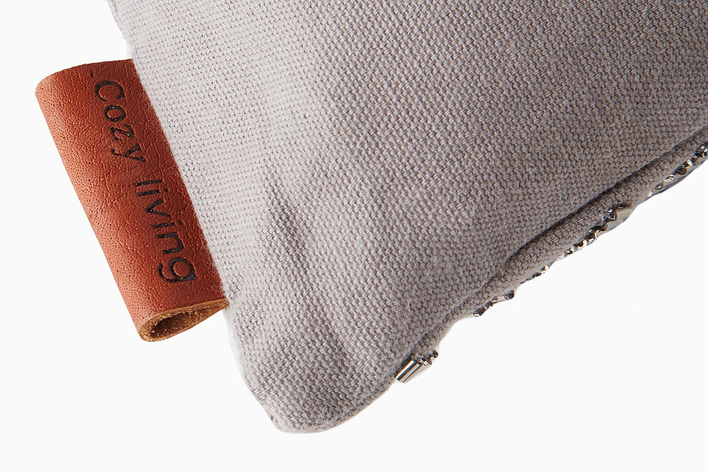 grey embroidered cushion