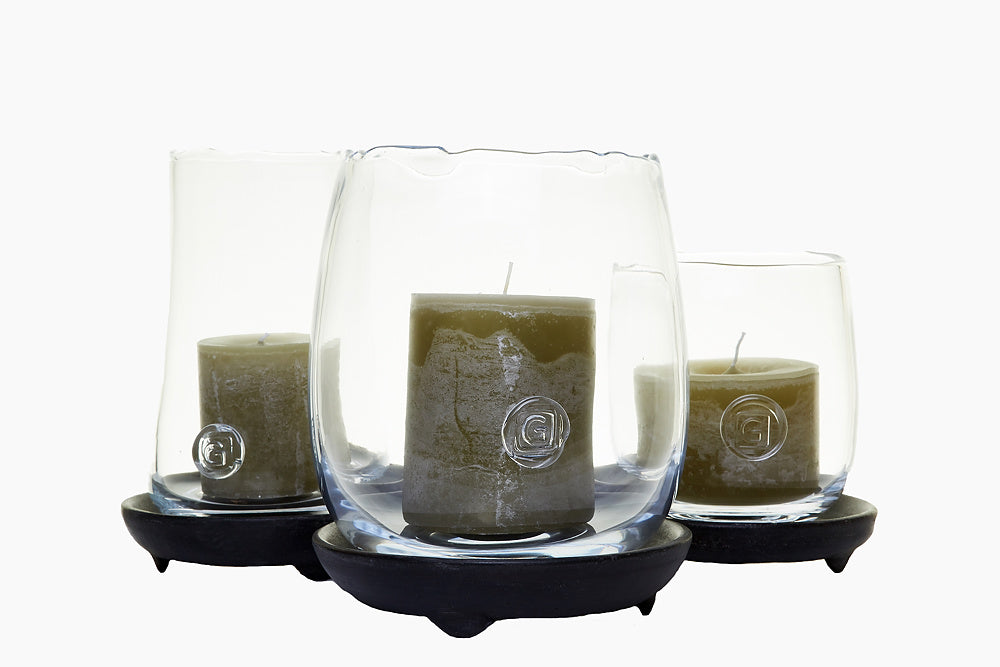 Olive candles in glass hurricane
