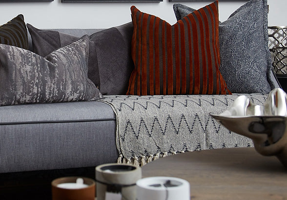 cushions and throw on a sofa