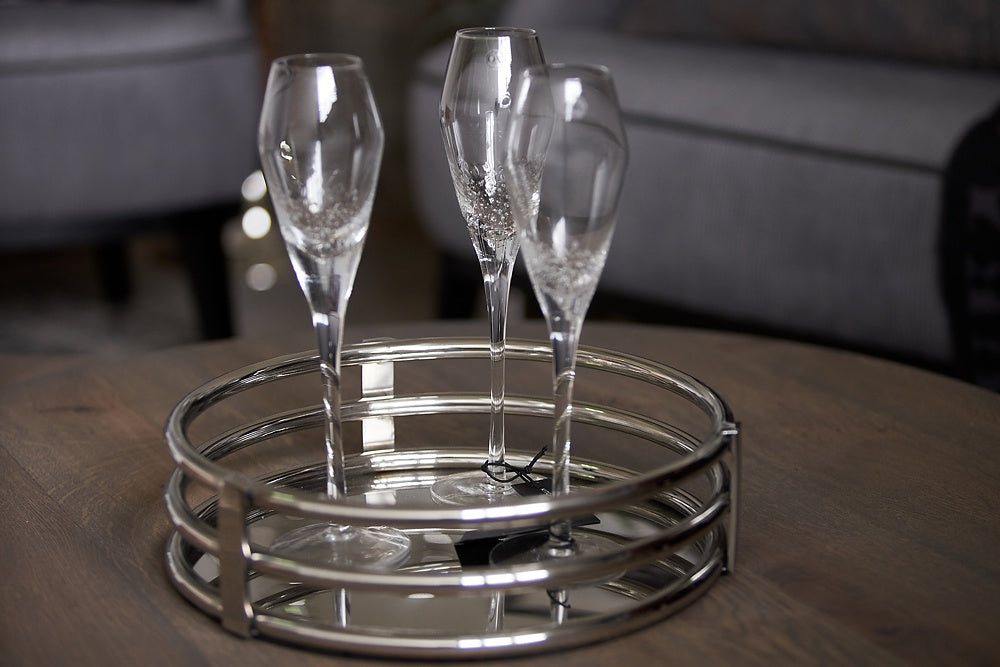champagne glasses on silver tray