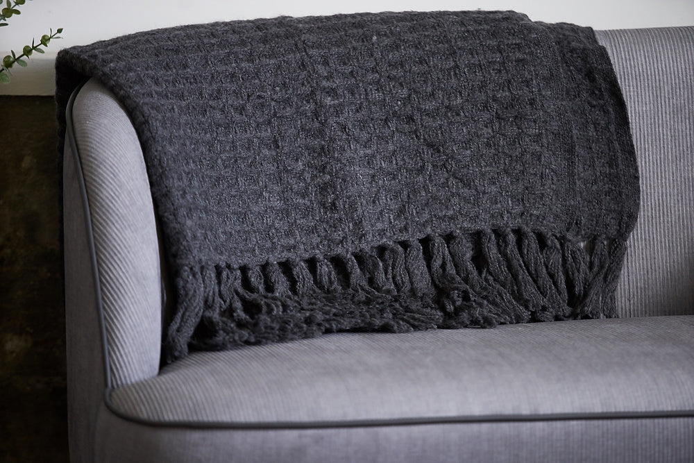 dark grey throw on sofa