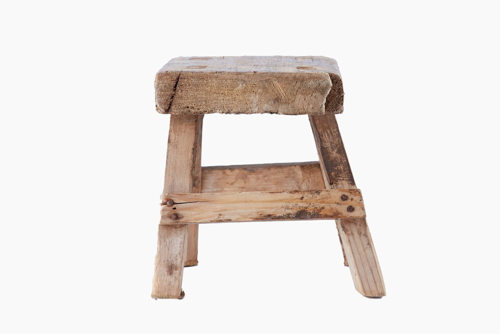 small wooden vintage stool neutral colour