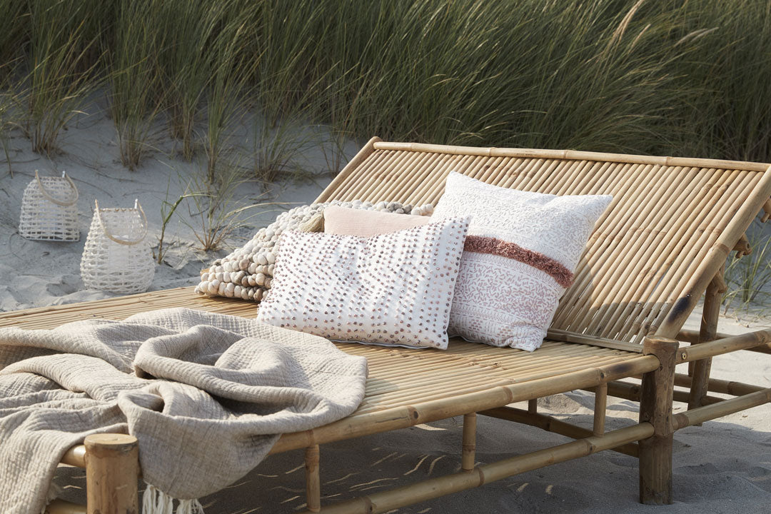 Sera Cushion off white on beach