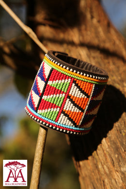 Wide leather bracelet in traditional beading