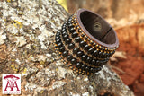 Wide leather bracelet in black big bead deign