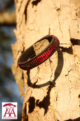 Leather wrap bracelets in red beading design