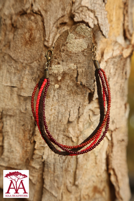 Single bead and leather wrap bracelet in red beading design