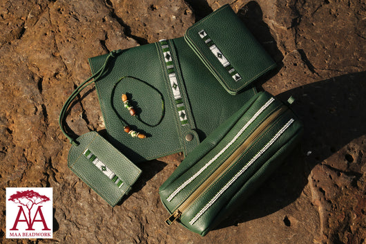 Travel accessories set in Green print leather