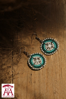 Disc earrings in teal-white fading