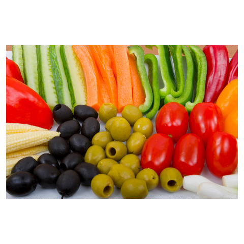 Crudities, green pepper, red pepper, carrot batons, cucumber sticks, baby corn, cherry tomatoes, green olives, black olives, spring onion