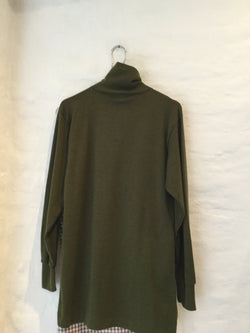 Green turtleneck sweater with a zipper in the back