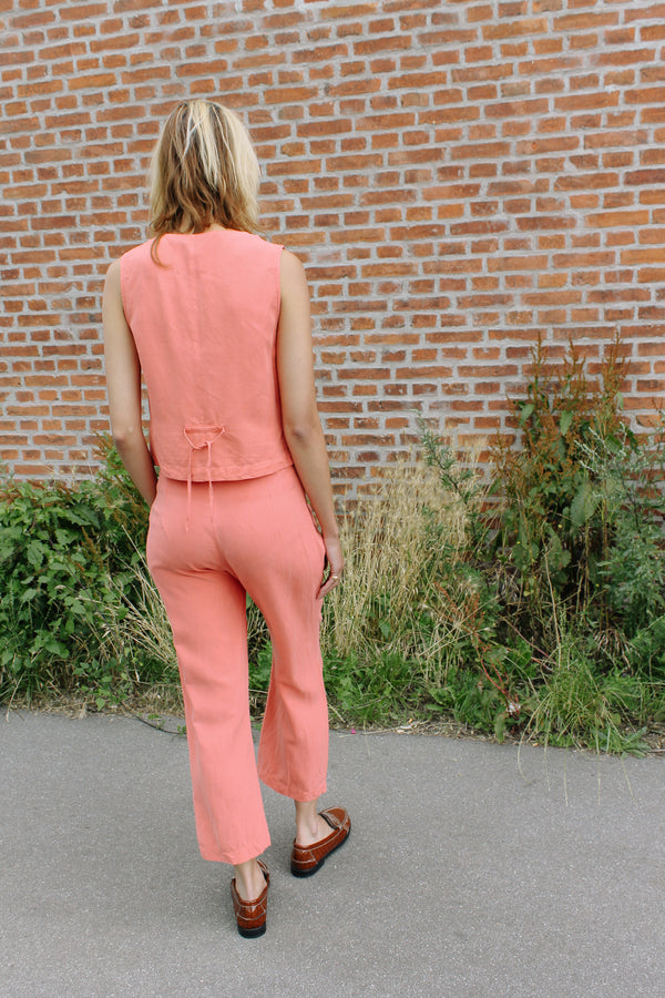 Coral pink trouser and top set, with floral embroidery.