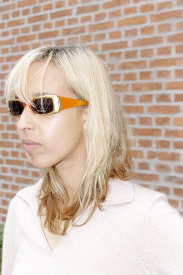 Miu Miu sunglasses in gold and orange hues