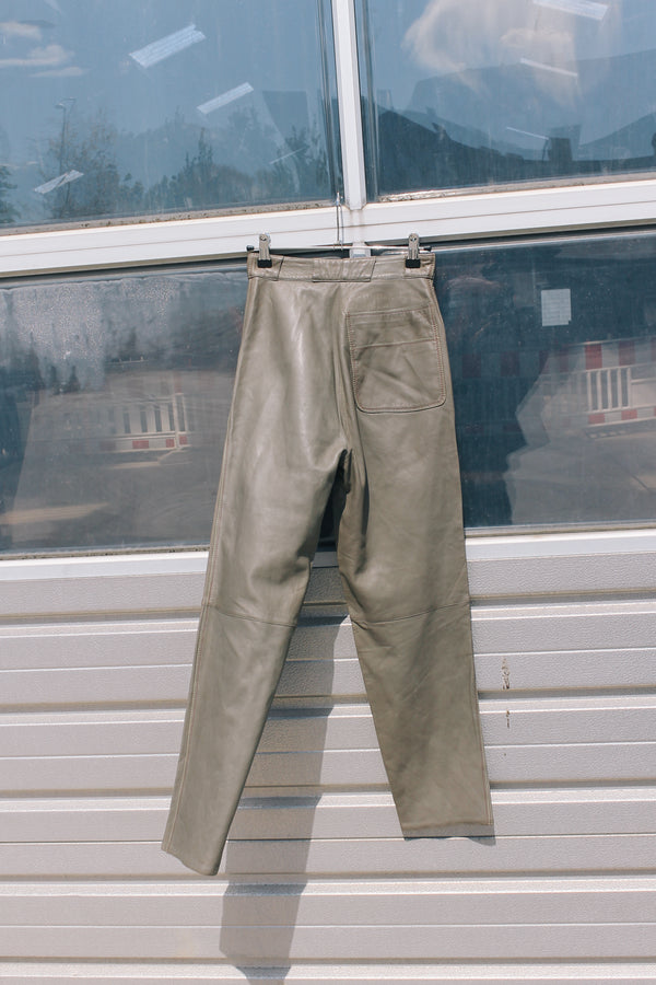 Dark beige leather trousers by Gianni Versace